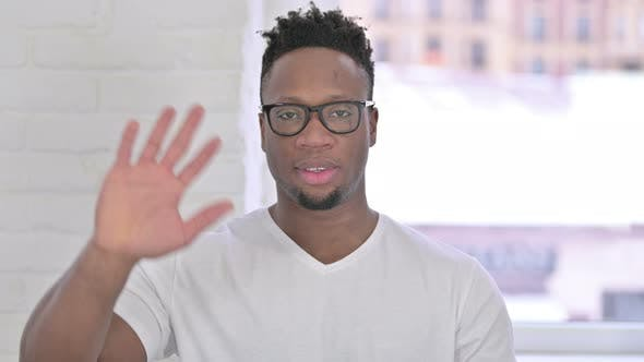 Thumbnail for Portrait of Casual African Man Waving at the Camera