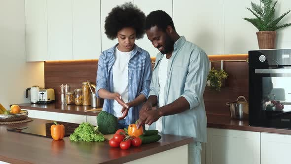 African american couple preparing food