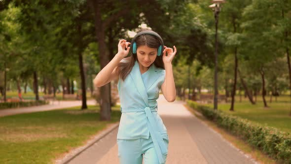 Thumbnail for Slim Businesswoman in Blue Elegant Suit Dance on Pedestrian Zone Have Fun Looking Camera
