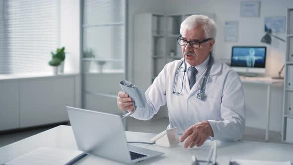 Doctor Instructing Patient Online