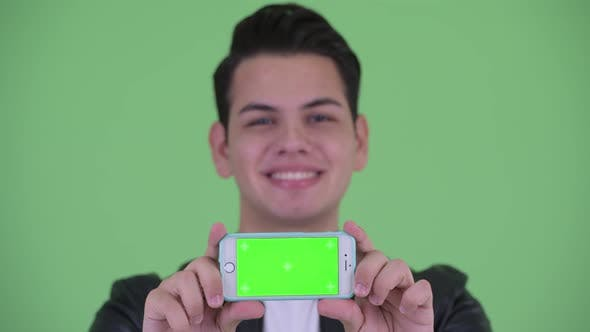 Thumbnail for Face of Happy Young Handsome Multi Ethnic Man Showing Phone