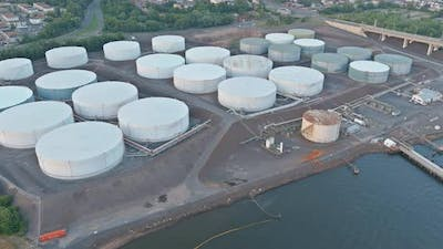 Aerial view equipment of oil refining with a large oil storage tank