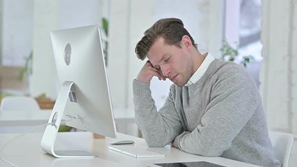 Thumbnail for Sleepy Creative Young Man Sleeping in Office
