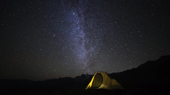 Time Lapse of Camping Tent and Campfire at Night