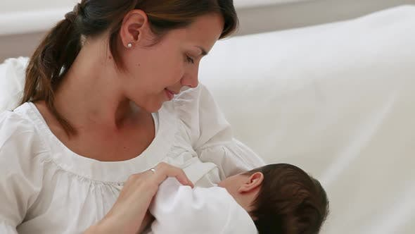 Thumbnail for Mother breastfeeding baby