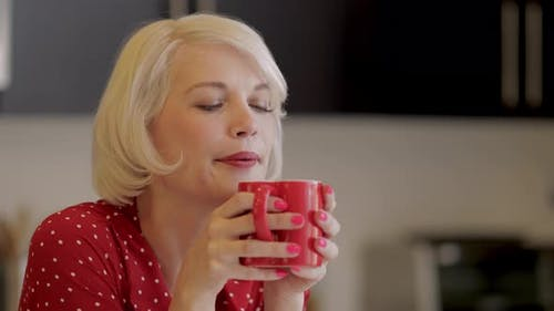 Attractive Woman Enjoying Her Coffee