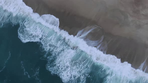 Amazing Wave Rolls on Sandy Beach on Nasty Day Aerial View