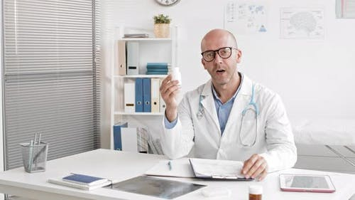 Male Doctor Promoting Pills