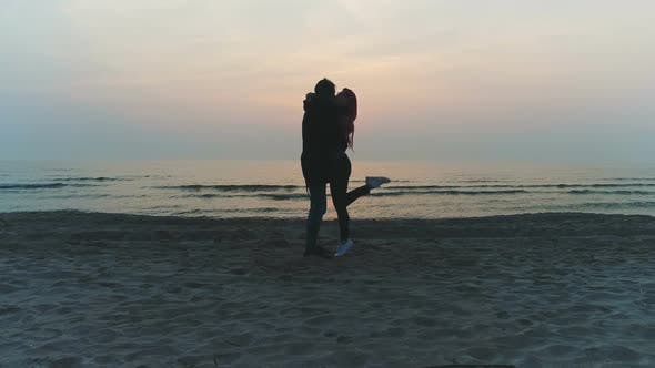 Hot Couple Kiss on the Beach During Sunset