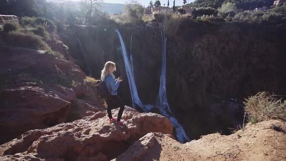Thumbnail for Tourist Standing On Cliff Edge Next To Ouzoud Falls