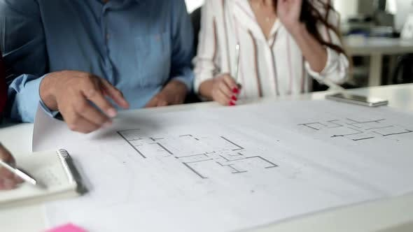 Thumbnail for Team of Business People Discussing Blueprint