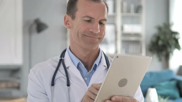 Thumbnail for Senior Doctor Using Tablet Computer