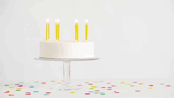 Thumbnail for Birthday Cake with Burning Candles on Table