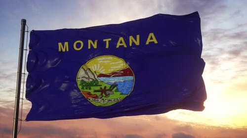 Flag of Montana Waving in the Wind Against Deep Beautiful Sky at Sunset