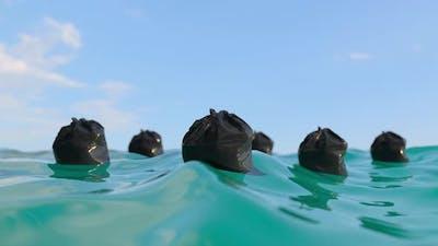 Garbage In Polluted Ocean Water