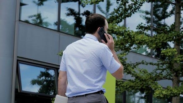Thumbnail for Urban Business Man Talking on Smart Phone Walking.