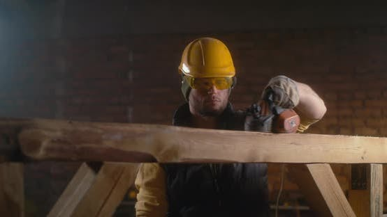 Male Joiner Working with Wood
