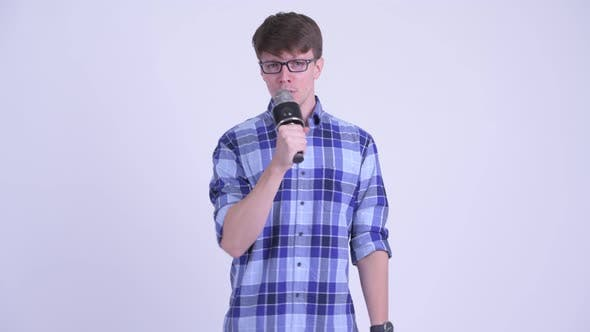 Thumbnail for Happy Young Handsome Hipster Man Singing with Microphone