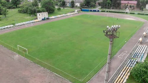 Sport stadium with green grass