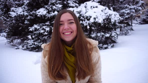 Thumbnail for Young Woman Rejoicing at First Day of Winter