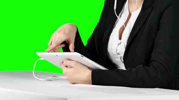 Cover Image for Businesswoman Using Laptop and Headset. Green Screen