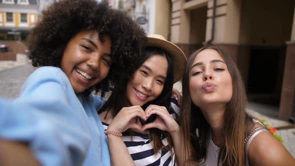 Cover Image for Cheerful Multi Ethnic Girls Taking Selfie Outdoors