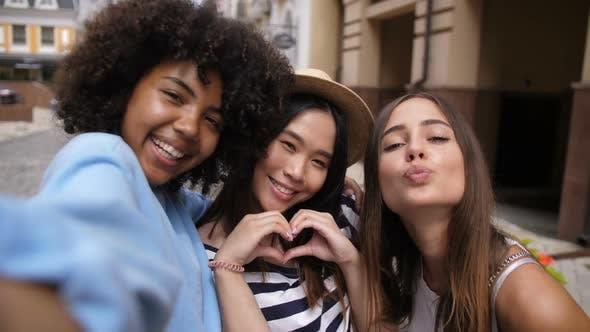 Thumbnail for Cheerful Multi Ethnic Girls Taking Selfie Outdoors
