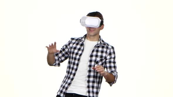 Thumbnail for Man Playing Online Game Wearing Virtual Reality Glasses. White Background