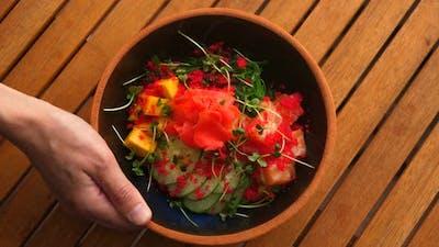 Top View of Fresh and Delicious Hawaiian Poke Bowl Traditional Hawaii Raw Fish Salad