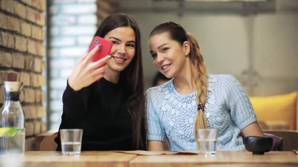 Thumbnail for Two Women Friends Take a Mobile Selfie Shot in Cafe