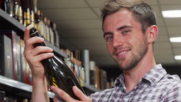 Thumbnail for Handsome Man Smiling To the Camera Holding Wine Bottle