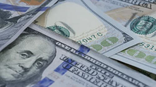 Rotating stock footage shot of $100 bills - MONEY 0131