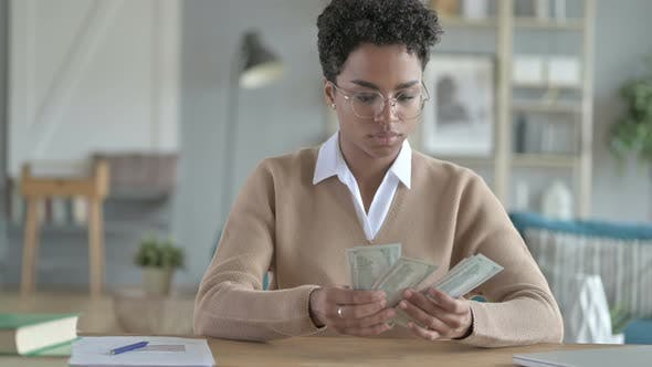 Beautiful African Girl Counting Money