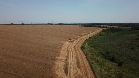 Cover Image for Aerial View of Combine Harvesters Agricultural Machinery. The Machine for Harvesting Grain Crops