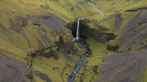 thin waterfall in the mountains of iceland