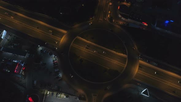Thumbnail for Roundabout Road with Car Lights in City at Night. Drone Top View of Sofia, Bulgaria