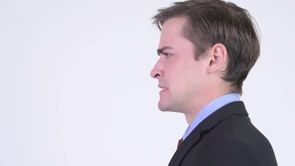 Cover Image for Profile View of Young Angry Businessman Shouting