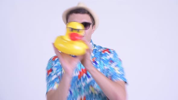 Thumbnail for Happy Young Handsome Tourist Man Dancing with Inflatable Duck