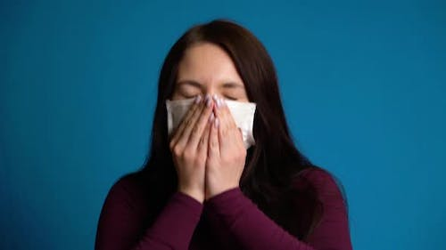 Woman Coughs Into Mask