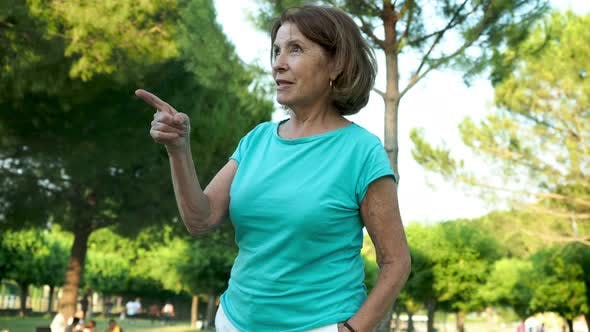 Thumbnail for Mature Woman Talking and Gesturing in Park