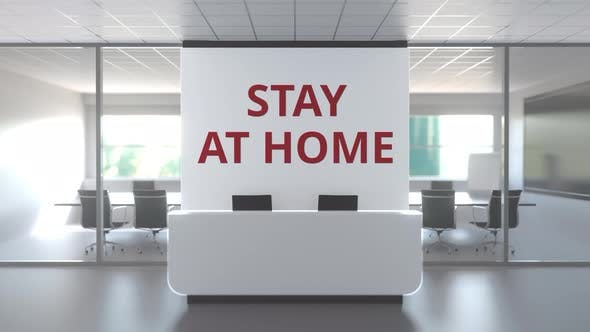 STAY AT HOME Text on the Wall of an Abandoned Generic Office