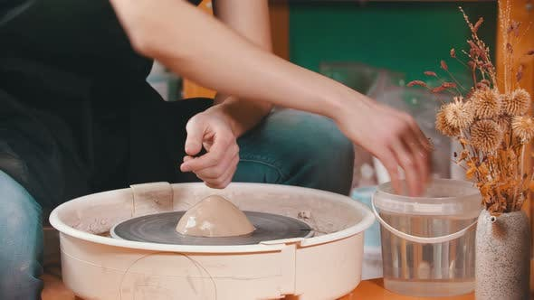 Thumbnail for Pottery - the Master Is Wetting the Clay for Better Glide