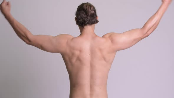 Thumbnail for Rear View of Muscular Man Flexing Biceps Shirtless Against White Background