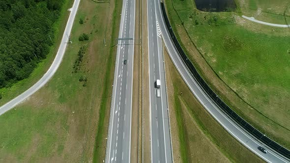 Thumbnail for Drone view of highway and overpass in the city
