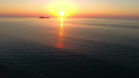 Thumbnail for Colorful Sunrise over Caribbean Sea with Pelicans Crossing Aerial Drone View