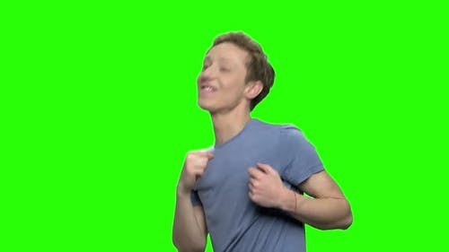 Energized Excited Teen Boy Dancing