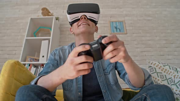 Thumbnail for Young Man Enjoying Games in VR Headset