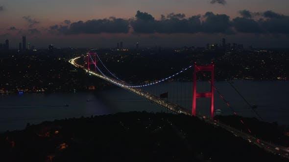 Thumbnail for Wide Establishing Shot of Bosphorus Bridge Illumination in Red Light in Istanbul, Turkey, Aerial