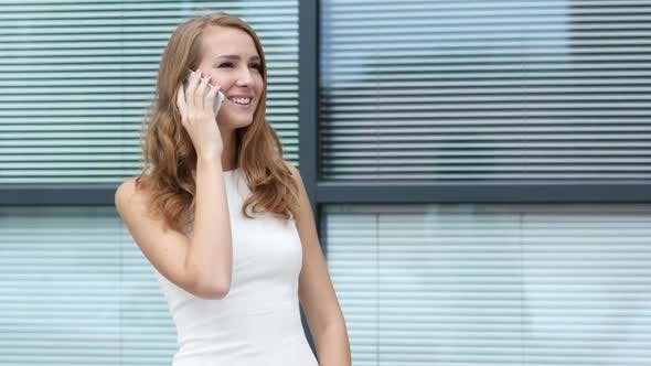 Thumbnail for Beautiful Girl Talking on Phone, Outside Office