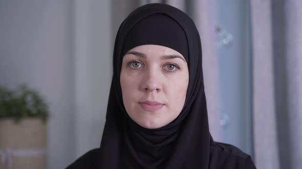 Thumbnail for Close-up Portrait of Young Beautiful Muslim Woman in Traditional Black Hijab. Charming Lady Looking